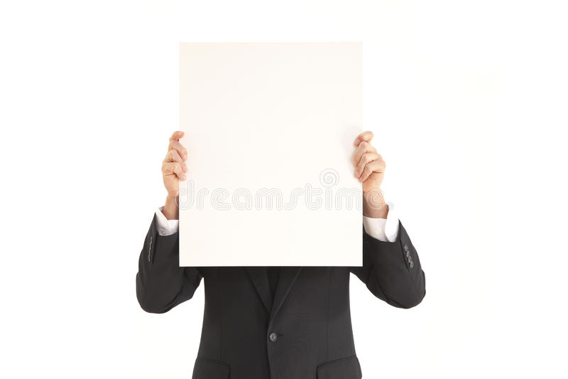 Businessman holding up blank poster stock photography