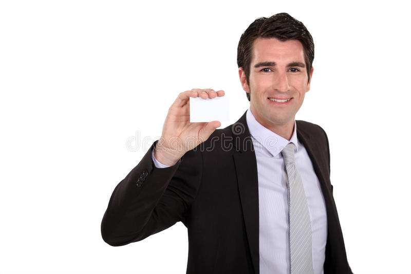 Businessman holding up hiscard royalty free stock image