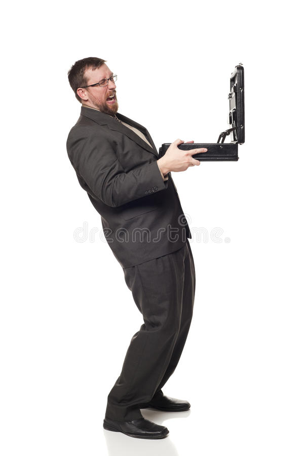 Businessman holding up open briefcase cringing. Isolated full length studio shot of the front view of a businessman holding up an open briefcase and cringing at royalty free stock photos