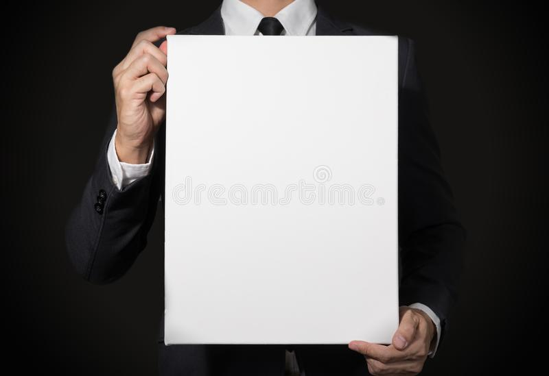 Businessman Holding white board with copy space for add text or stock photos