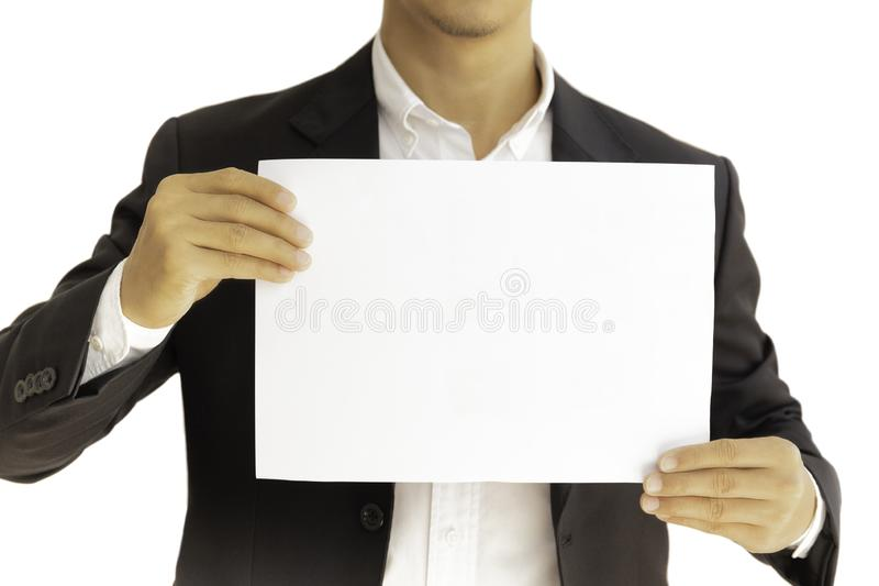 Businessman holding white clear paper board in hands isolated in clipping path. stock image