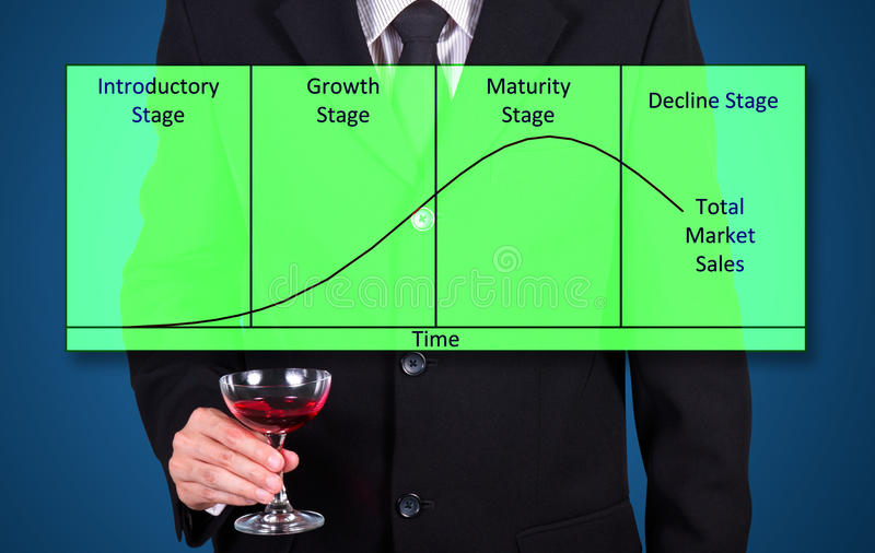 Businessman holding wine glass show success business statistic g. Raph on blue stock photo