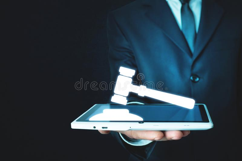Businessman holding wooden gavel with sound block. royalty free stock photo
