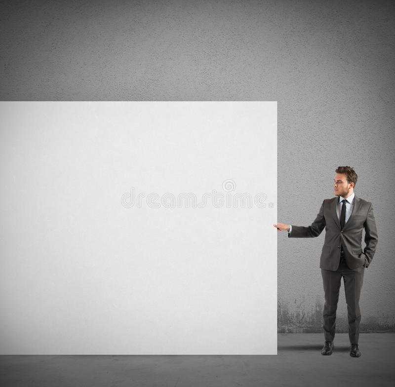 Businessman holds a blank billboard stock image