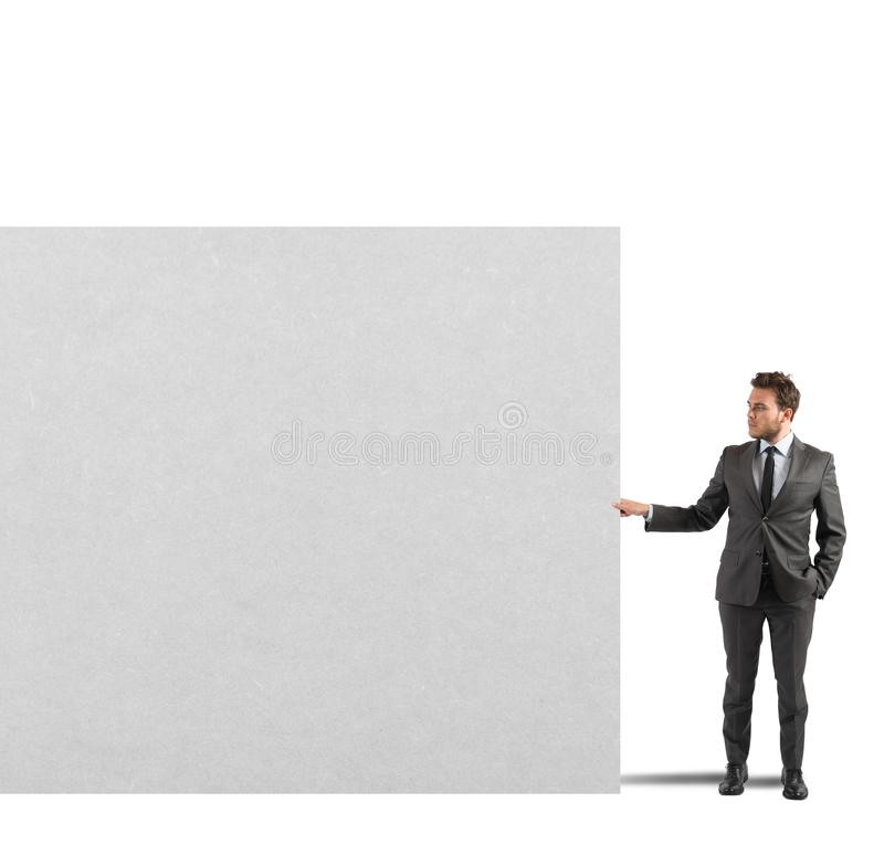 Businessman holds a blank billboard royalty free stock images