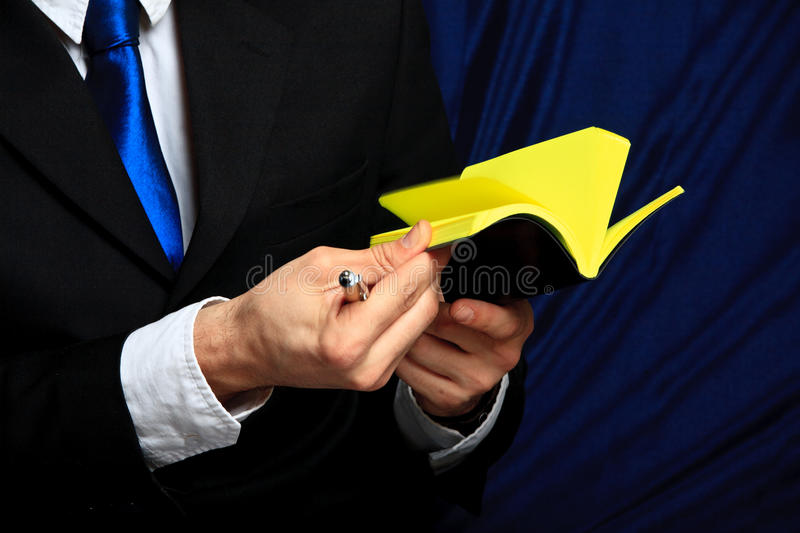 Businessman holds his notebook royalty free stock photos