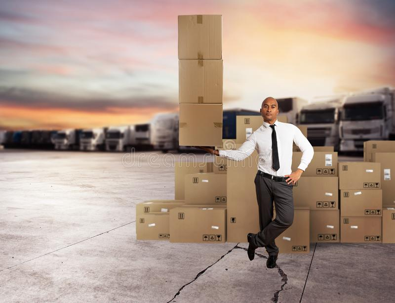 Businessman holds a pile of packages in a hand. concept of fast delivery. Businessman holds a pile of packages in a hand. concept of fast and easy delivery royalty free stock photo