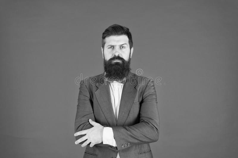 Businessman or host fashionable outfit red background. Formal outfit. Confident posture. Man bearded hipster wear stock image