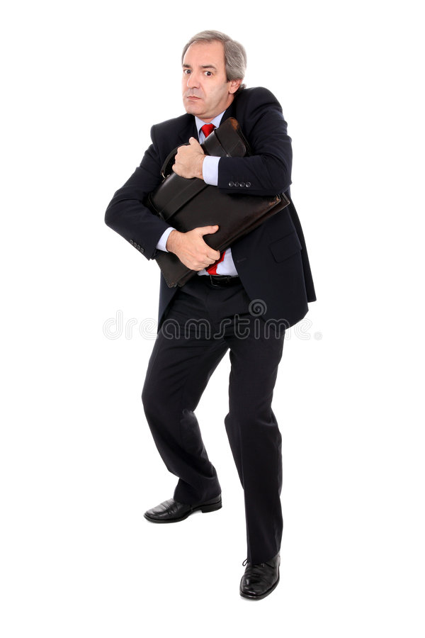 Businessman hugging briefcase. Mature businessman clutching briefcase with scared expression, isolated on white background royalty free stock image