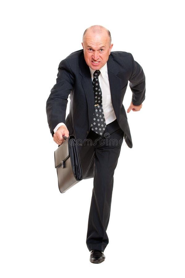 Businessman hurrying to job royalty free stock image