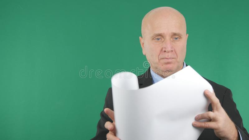 Businessman Image Opening And Reading Technical Projects stock photography