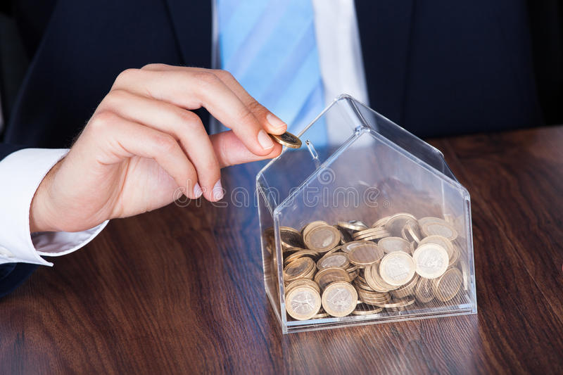 Download Businessman Inserting Coin In Box Stock Photo - Image of insurance, male: 46895084