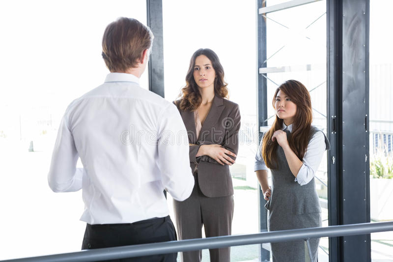 Businessman interacting with team royalty free stock photo