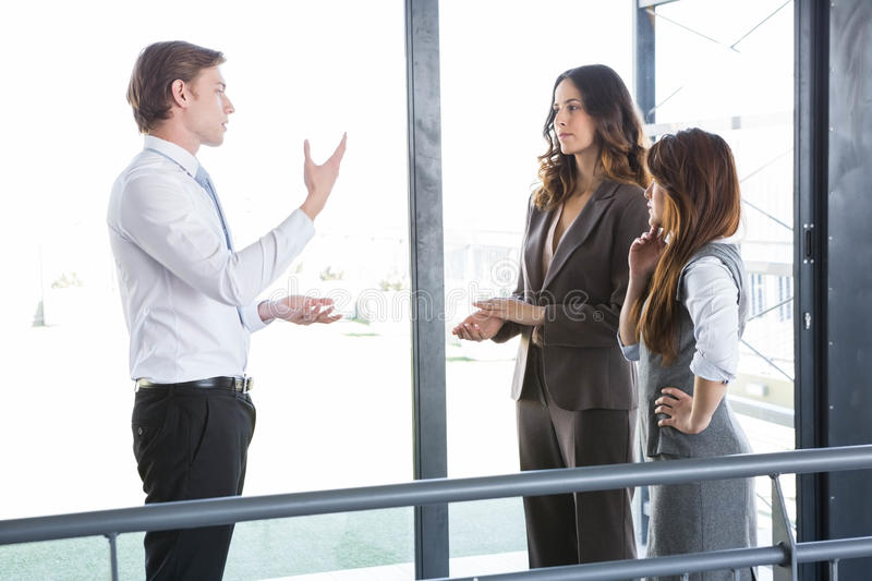 Businessman interacting with team royalty free stock photos
