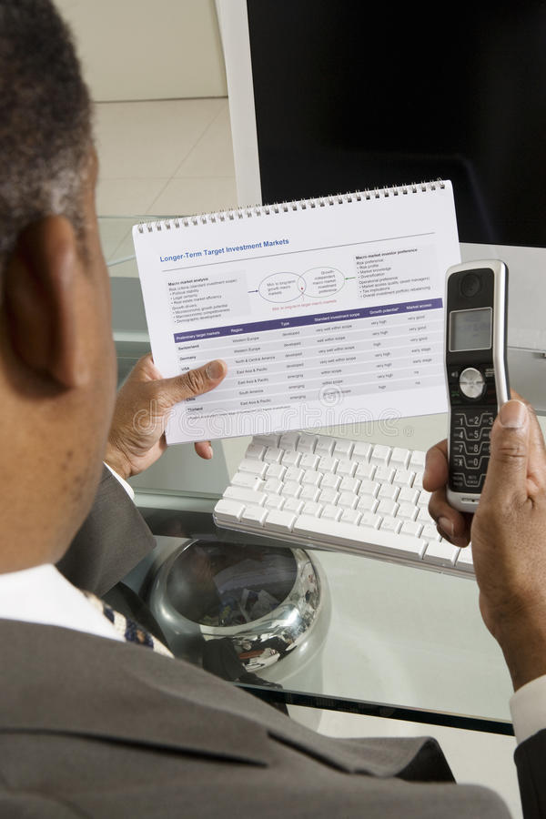 Download Businessman With Investment Form And Cell Phone Stock Image - Image: 29660971