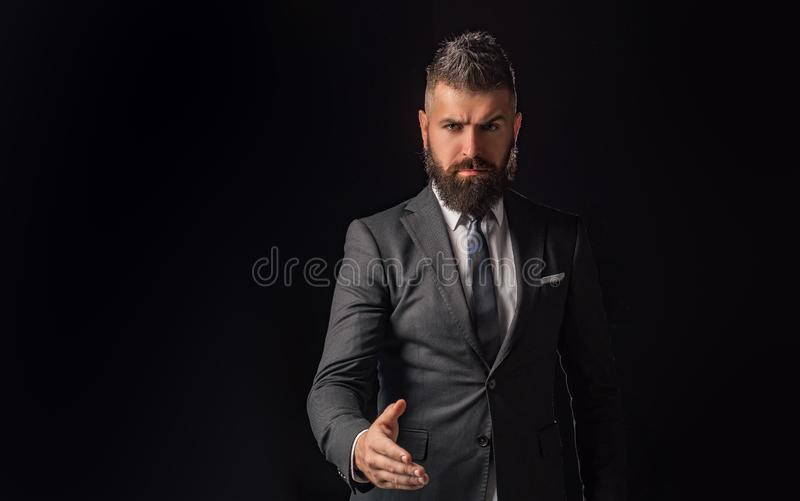 Businessman isolated - handsome man with woman standing on black background. Businessman shaking hands. Business concept stock photography
