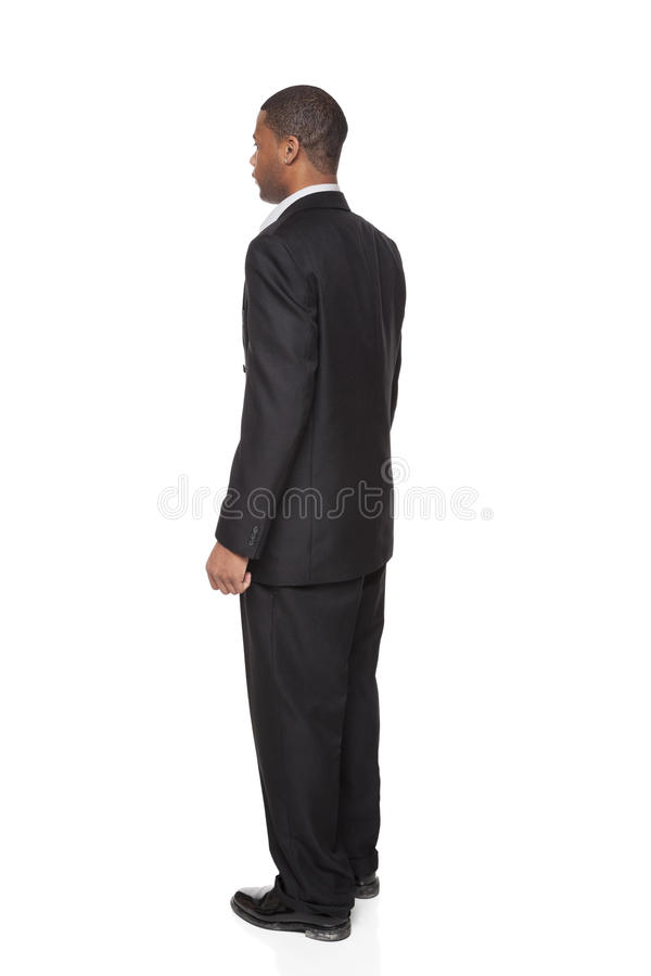 Businessman isolated on white Rear View stock photography