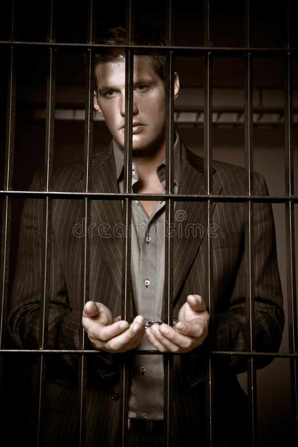 Businessman in jail stock image