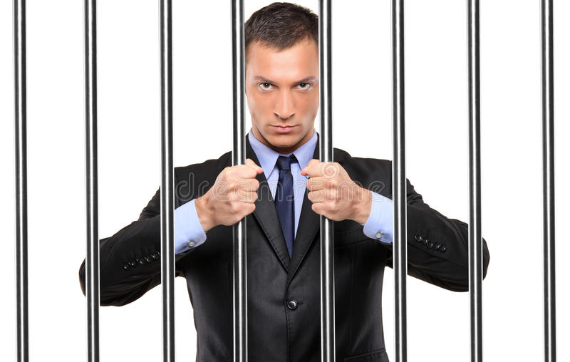 Download A Businessman In Jail Holding Bars Stock Image - Image: 15803623