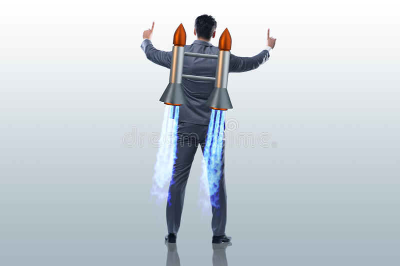 The businessman with jet pack in business concept royalty free stock photo