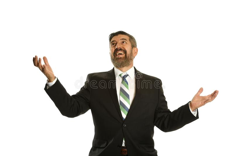 Businessman showing ecitemment looking up. Businessman Juggling with imaginary objects isolated on a white background royalty free stock image