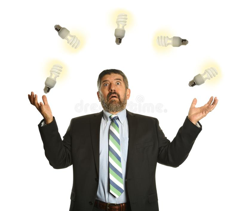 Businessman Juggling with light bulbs. Isolated on a white background stock photo