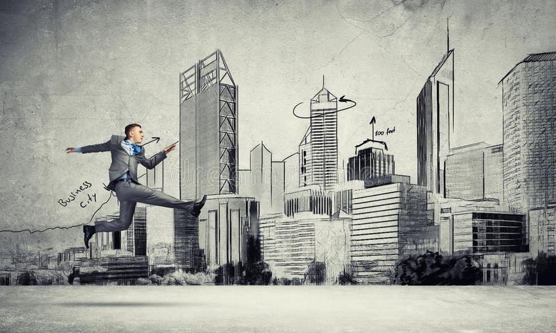Businessman jumping high. Young businessman in room running in a hurry royalty free stock image