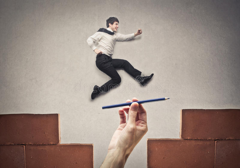 Businessman jumping high stock images