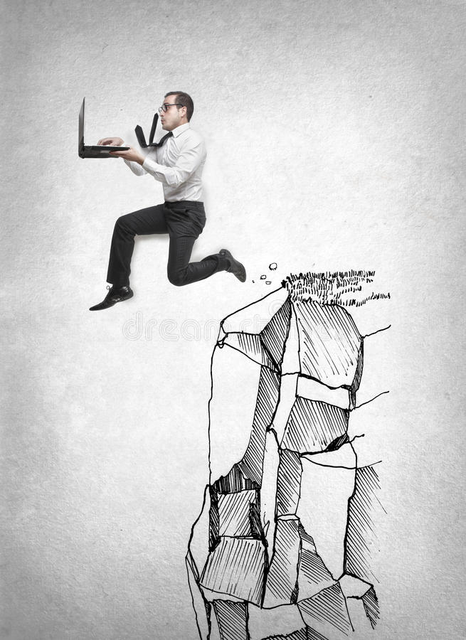 Businessman jumping with his laptop royalty free stock images
