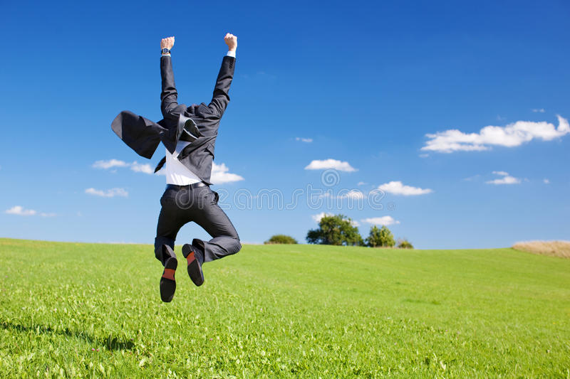 Businessman jumping for joy royalty free stock image