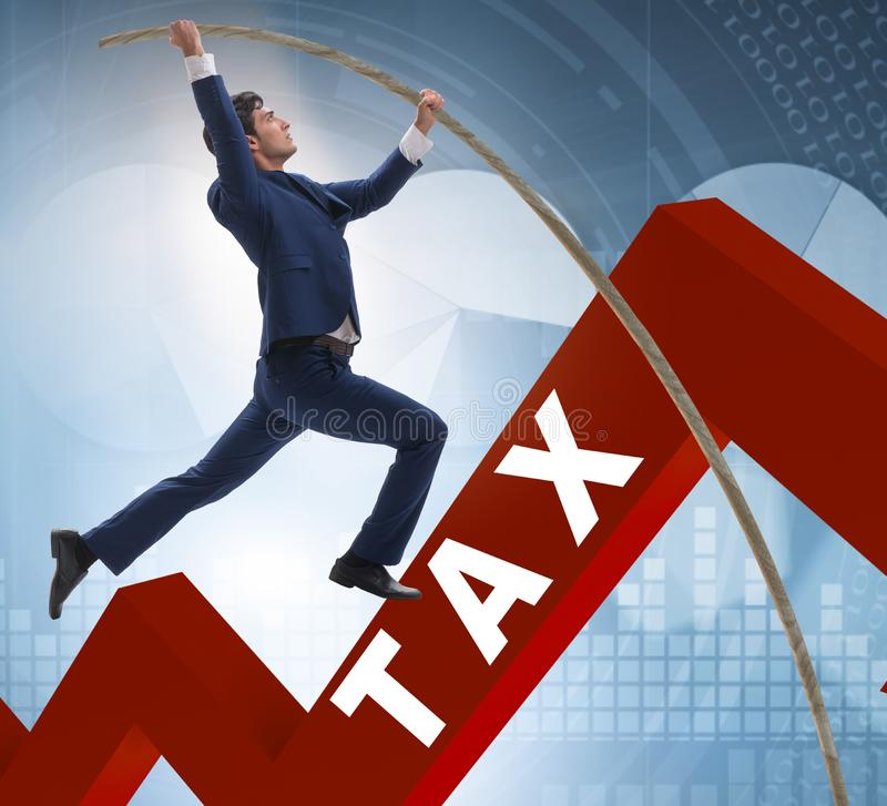 Businessman Jumping Over Tax In Tax Evasion Avoidance Concept Stock Image