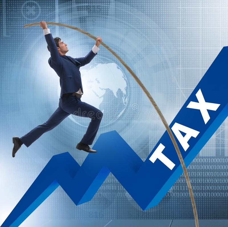 Businessman jumping over tax in tax evasion avoidance concept. The businessman jumping over tax in tax evasion avoidance concept royalty free stock image