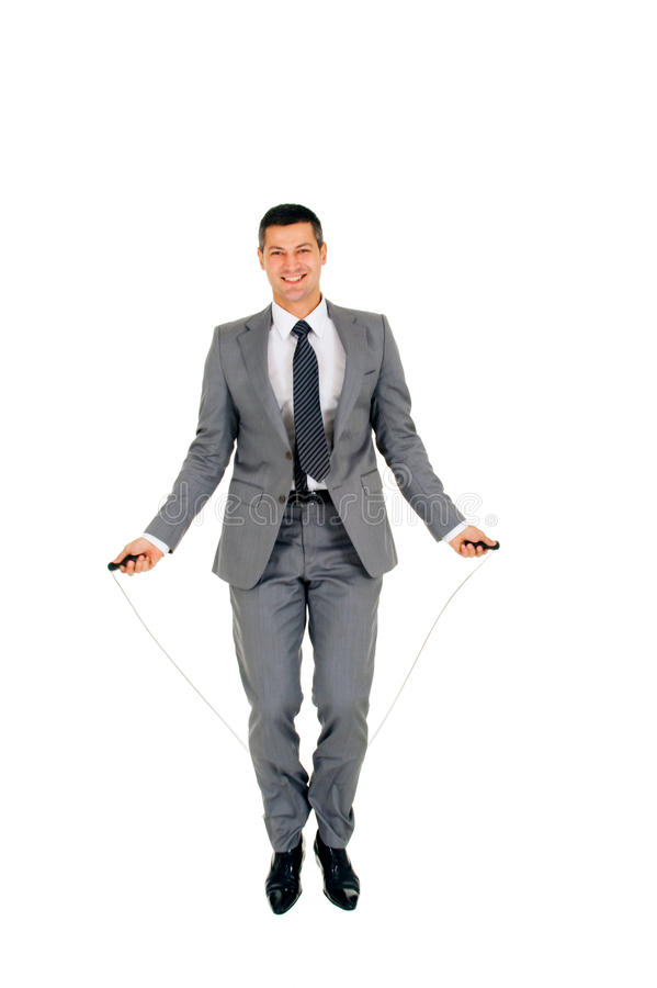 Businessman jumping rope royalty free stock image