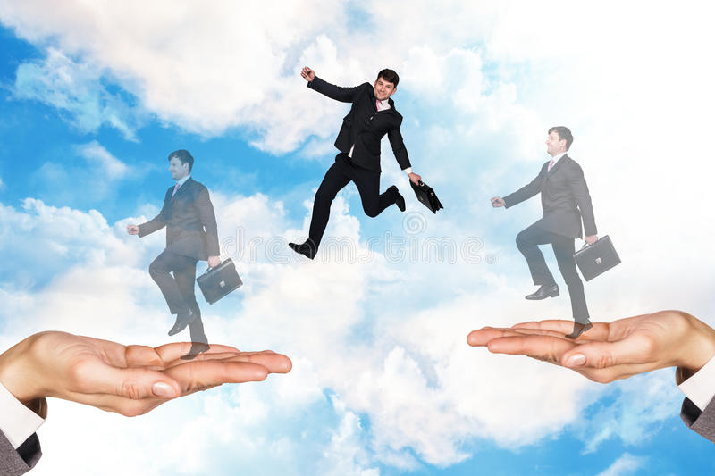Businessman jumping in the sky royalty free stock photos