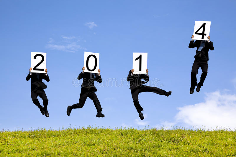 Businessman Jumping With 2014 Year Royalty Free Stock Photography