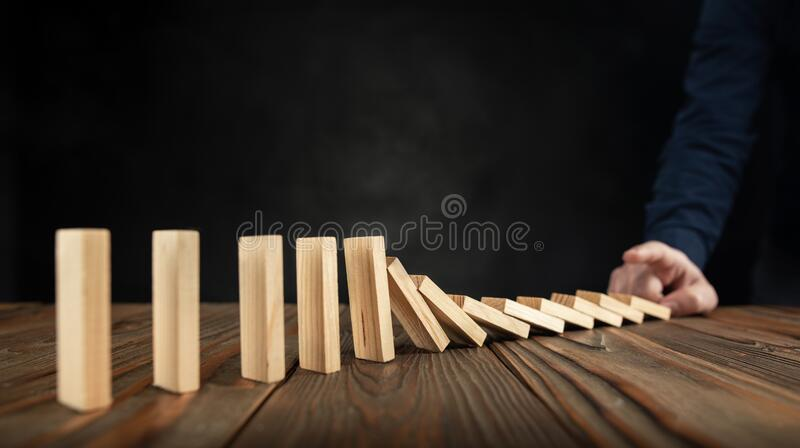 Businessman Just Starting Domino Effect. royalty free stock photos