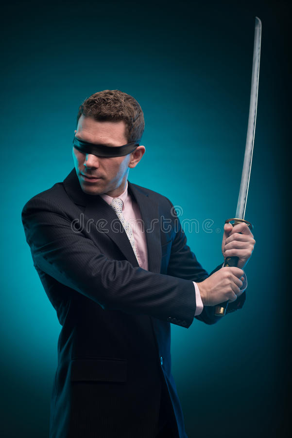 Businessman with katana sword stock photography