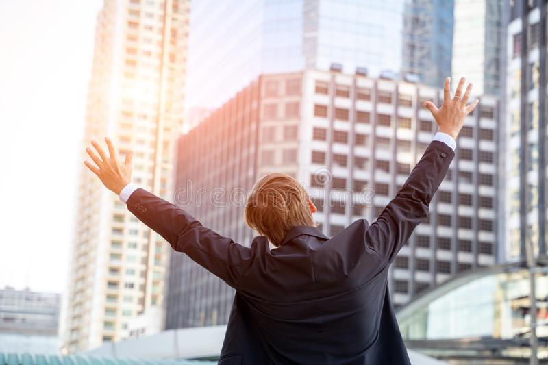 Businessman keeping arms raised and expressing positivity,Celebrating success royalty free stock photography