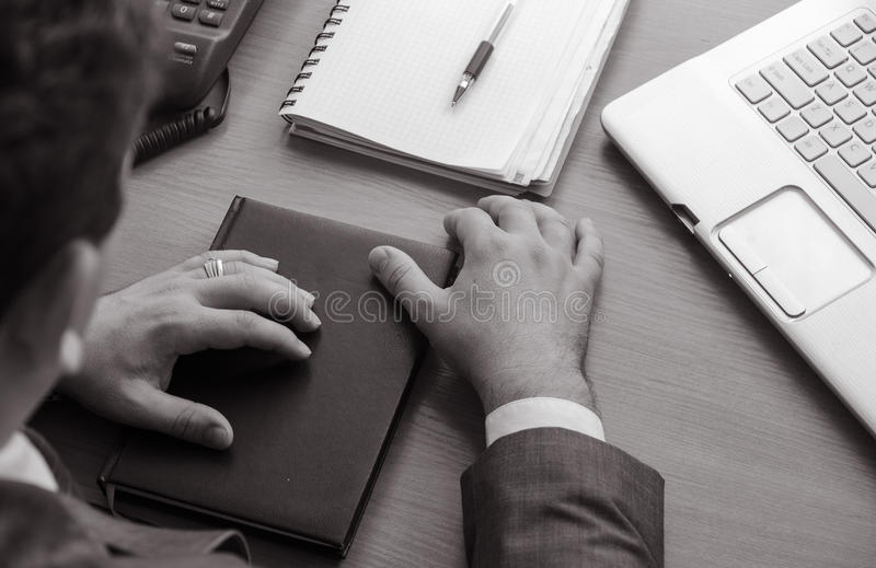 The businessman keeps his hands on a closed notebook stock photos