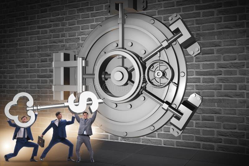 The businessman with key near bank vault door. Businessman with key near bank vault door stock image
