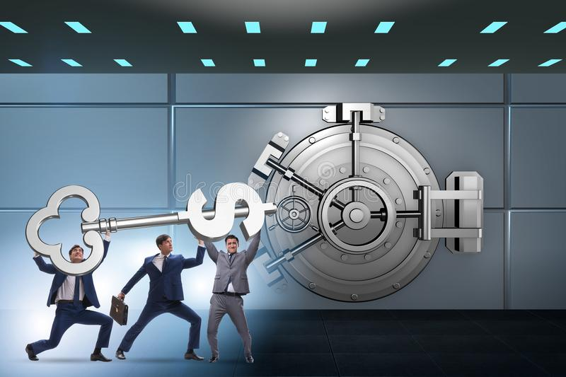 The businessman with key near bank vault door. Businessman with key near bank vault door royalty free stock photography