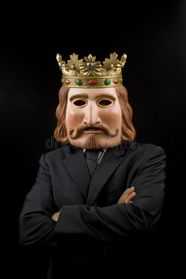 Businessman with king mask and crossed arms stock photos