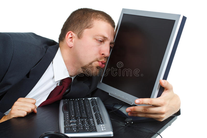 Businessman kissing his notebook royalty free stock photography