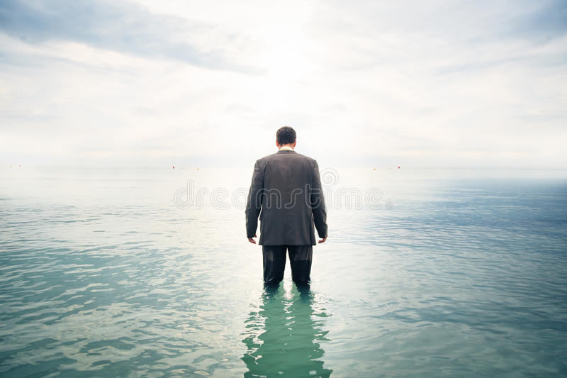 Businessman Knee-deep In Water royalty free stock photos