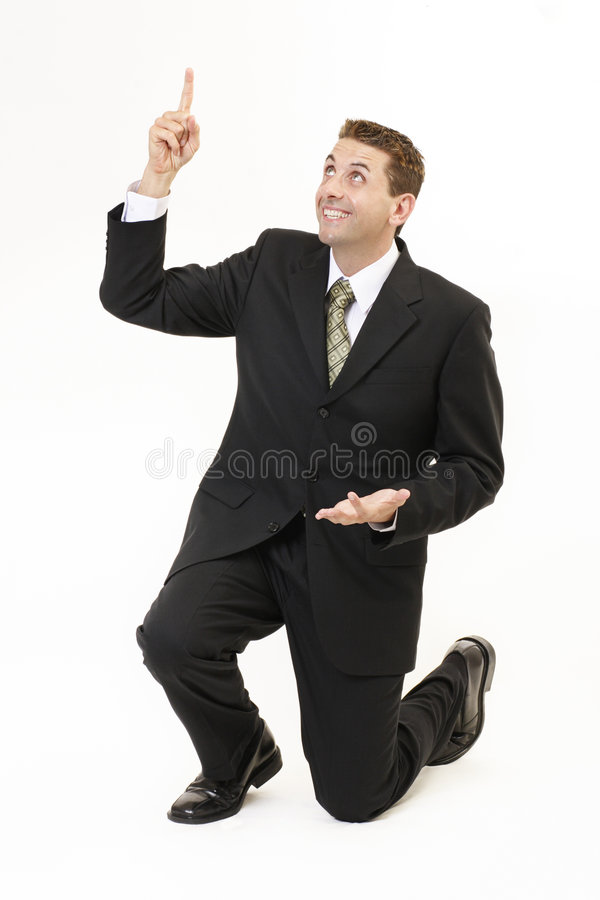 Businessman on knees 2 royalty free stock photo