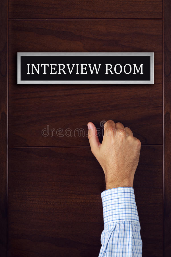 Businessman knocking on interview room door. Man applying for a job, career opportunity concept stock photo