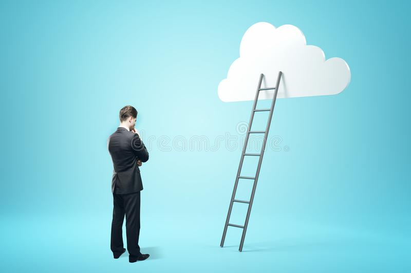 Success, growth and freedom concept. Businessman with ladder and cloud on blue background. Success, growth and freedom concept stock image