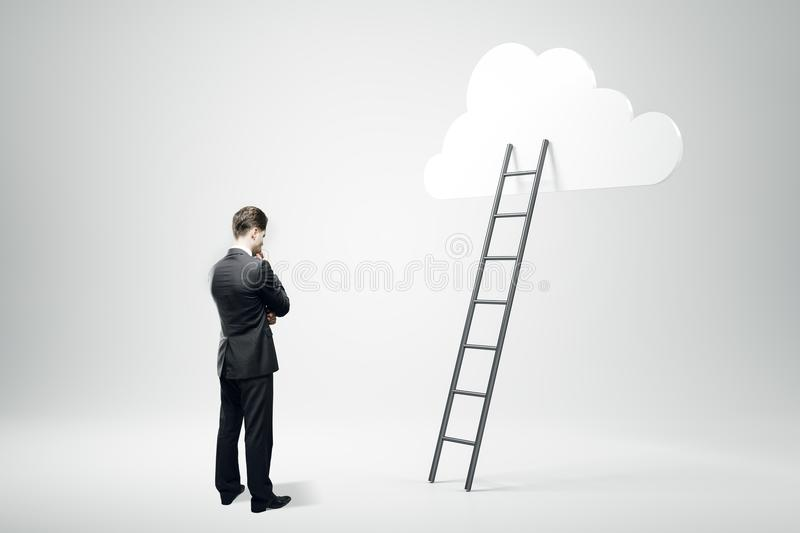 Success, growth and future concept. Businessman with ladder and cloud on gray background. Success, growth and future concept royalty free stock photography