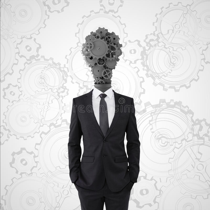 Businessman. With lamp-head in form gears stock photography
