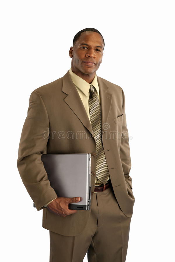 Businessman with laptop. Serious African American businessman holding laptop computer on white background